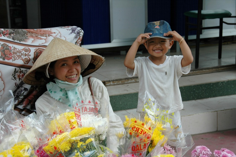 Mother and Son Selling Flowers - Mekong Delta, Vietnam