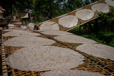 Coconut paper laid out to dry in the sun.