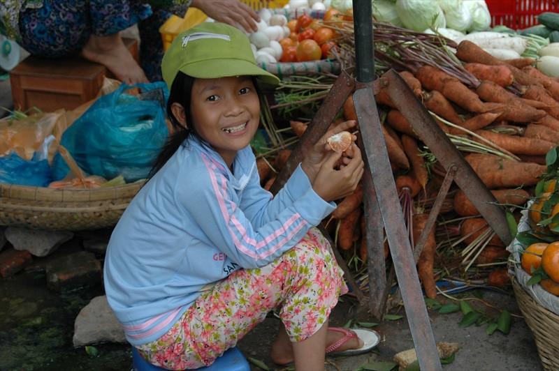 Woman Eating Oranges - Mekong Delta, Vietnam