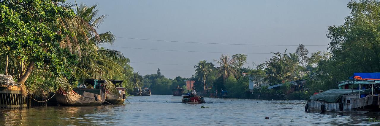 Sunrise boat traffic on the Cổ Chiên River.