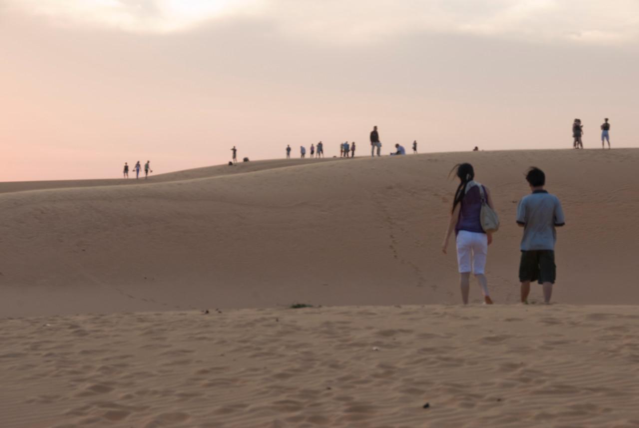 Tourists exploring the White Sand Dunes- Mui Ne, Vietnam