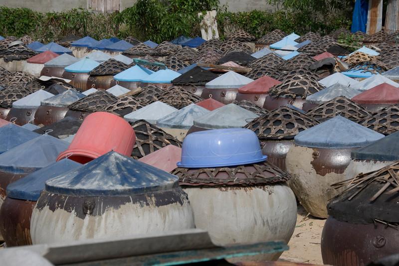 Jars filled with fish sauce in fishing village - Mui Ne, Vietnam