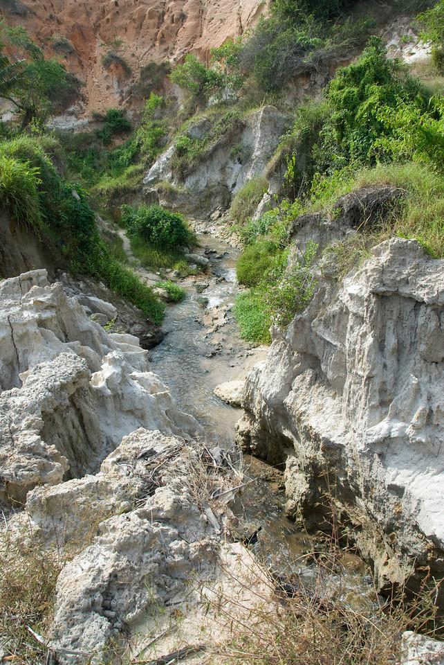Looking down an eroded valley and rock cliffs - Mui Ne, Vietnam