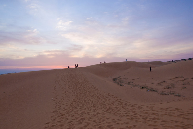 Beautiful sunset clouds over the white sand dunes - Mui Ne, Vietnam