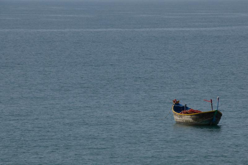 Solitary boat floating in water - Mui Ne, Vietnam