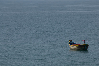 Solitary boat floating in water - Mui Ne, Vietnam