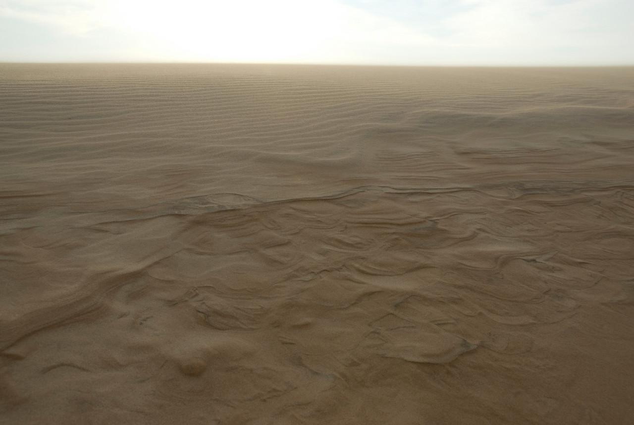 Wind blowing at the white sand dunes - Mui Ne, Vietnam