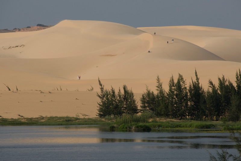 View of the white sand dunes across the stream - Mui Ne, Vietnam