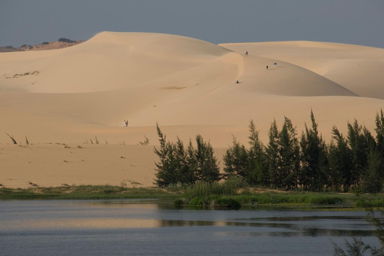 View of the white sand dunes across the stream - Mui Ne, Vietnam
