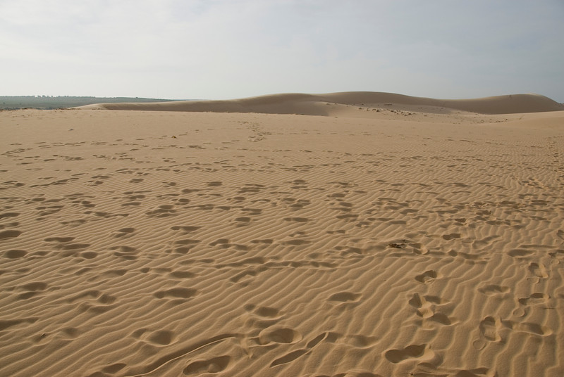 Footsteps on the white sand dunes in Mui Ne, Vietnam