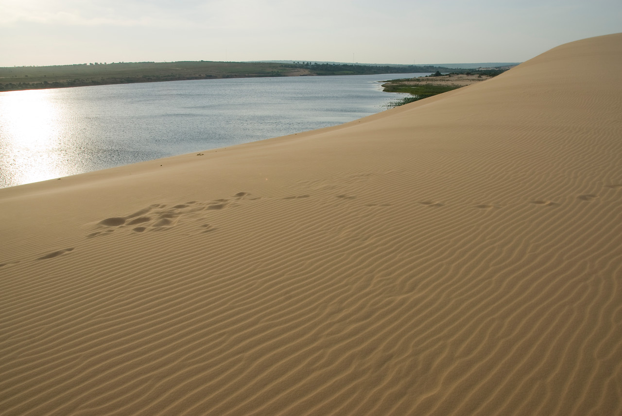 Footsteps and wind marks at the white sand dunes - Mui Ne, Vietnam