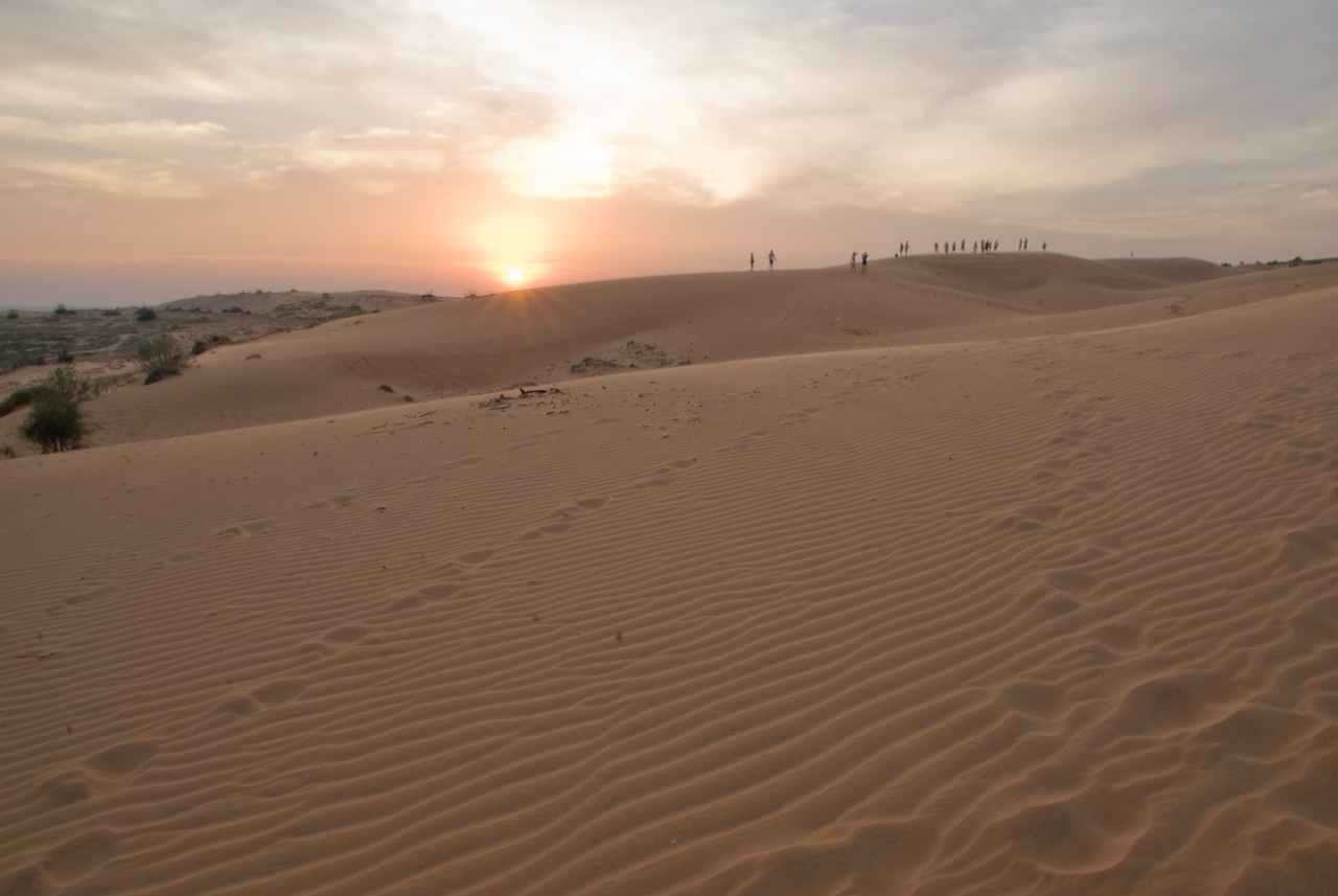 Sunset beaming over the white sand dunes - Mui Ne, Vietnam