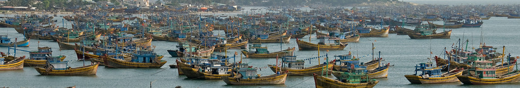 Panoramic shot of the boats in the fishing village - Mui Ne, Vietnam