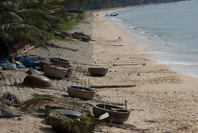 Palm fronds and jars on the beach - Mui Ne, Vietnam