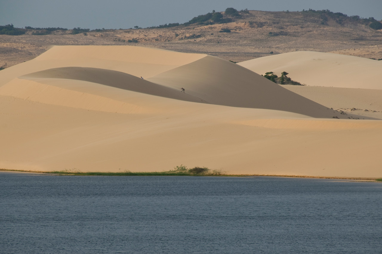 White sand dunes in between mountain and stream - Mui Ne, Vietnam