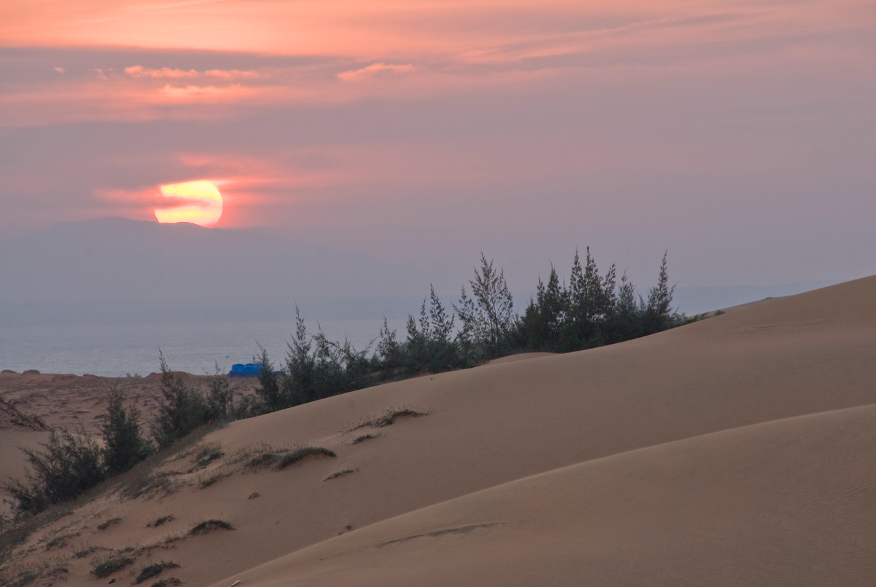 Sun setting above the white sand dunes - Mui Ne, Vietnam