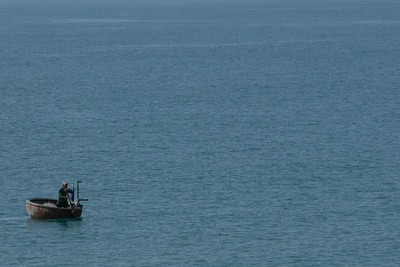 Man on a fishing boat -  Mui Ne, Vietnam