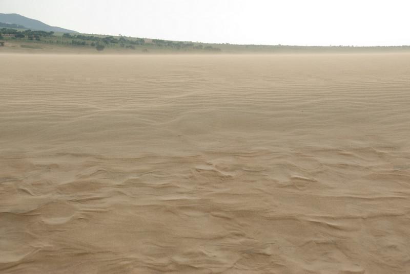 Sands blown over the white sand dunes - Mui Ne, Vietnam