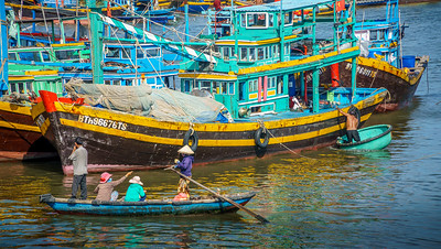 Colorful life scene around the fishing boats at Phan Thiet.