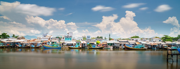 Picturesque houses on stilts around Sông Cà Ty River at Phan Thiet.