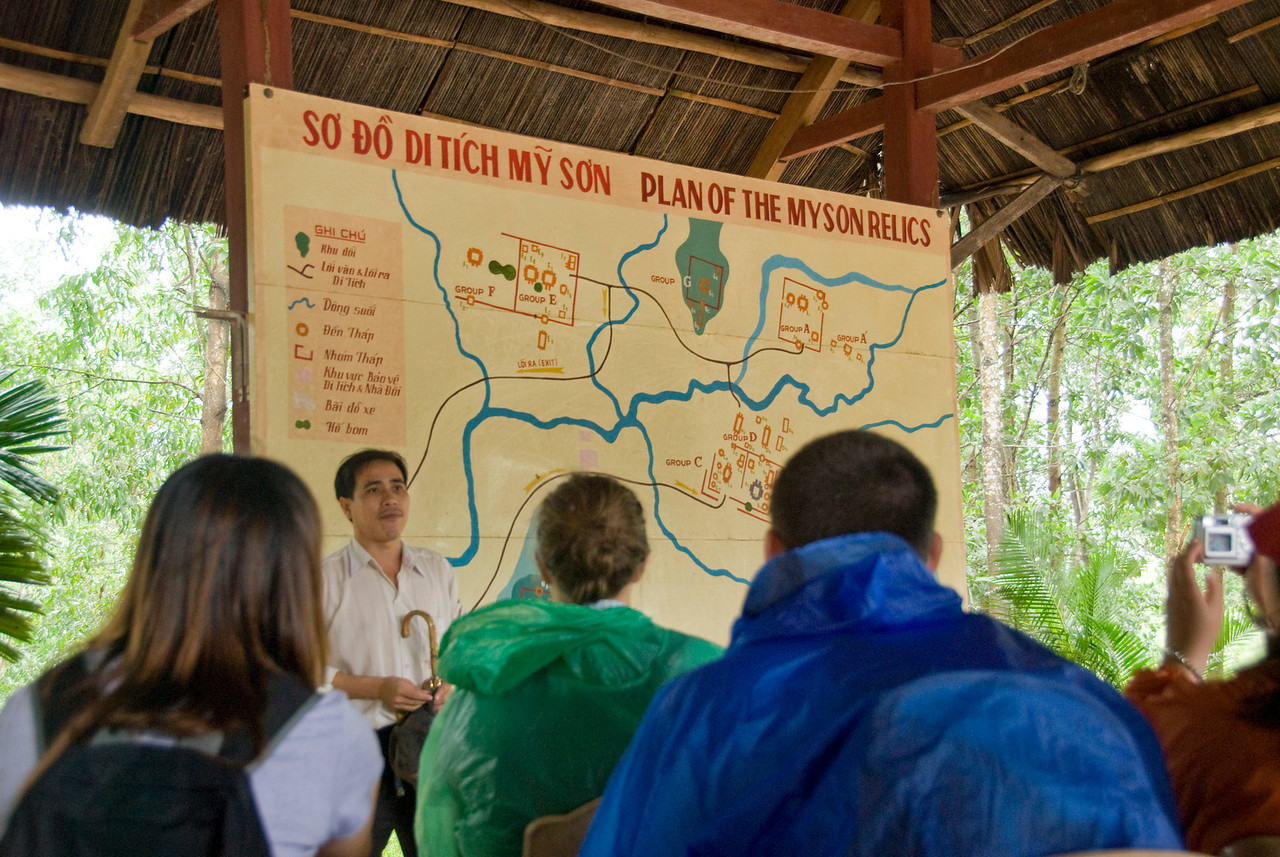 Tour Guide explaining area map to tourists - My Son Sanctuary, Vietnam