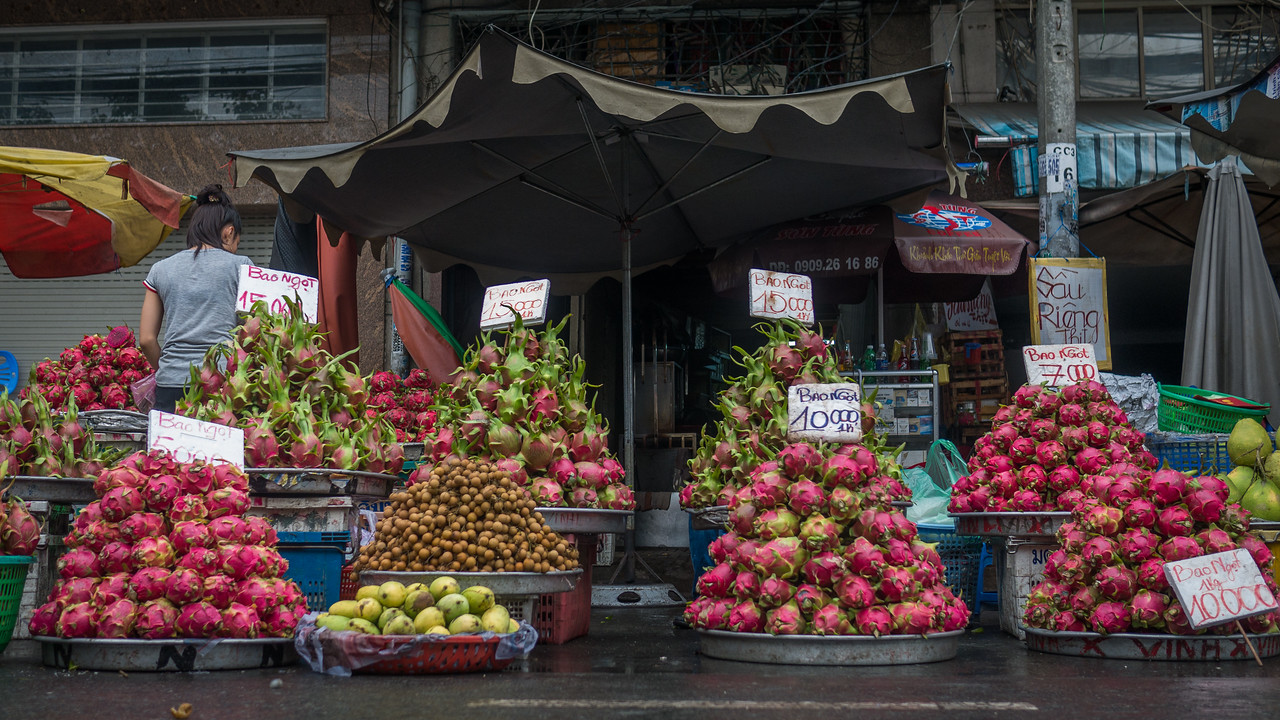 A colorful market in Ho Chi Minh City on a rainy day.
