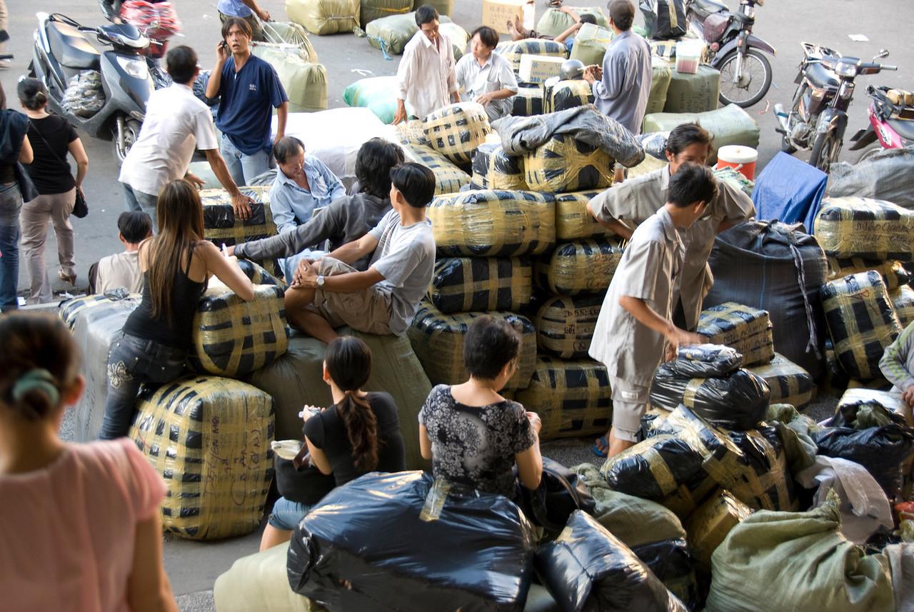 Bushels of clothes outside the Hong Kong Market - Saigon, Vietnam