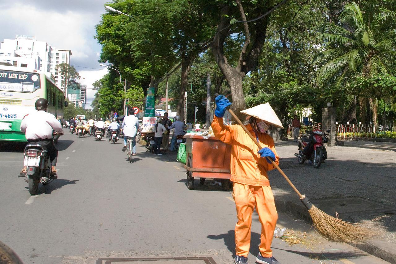 Street sweeper in Saigon, Vietnam