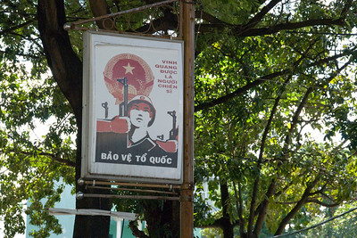 Propaganda Sign on a tree in Saigon, Vietnam