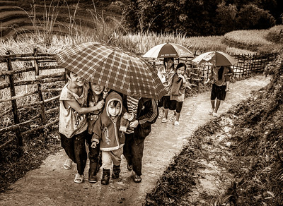 Group of kids met on our way and fighting the rain too.