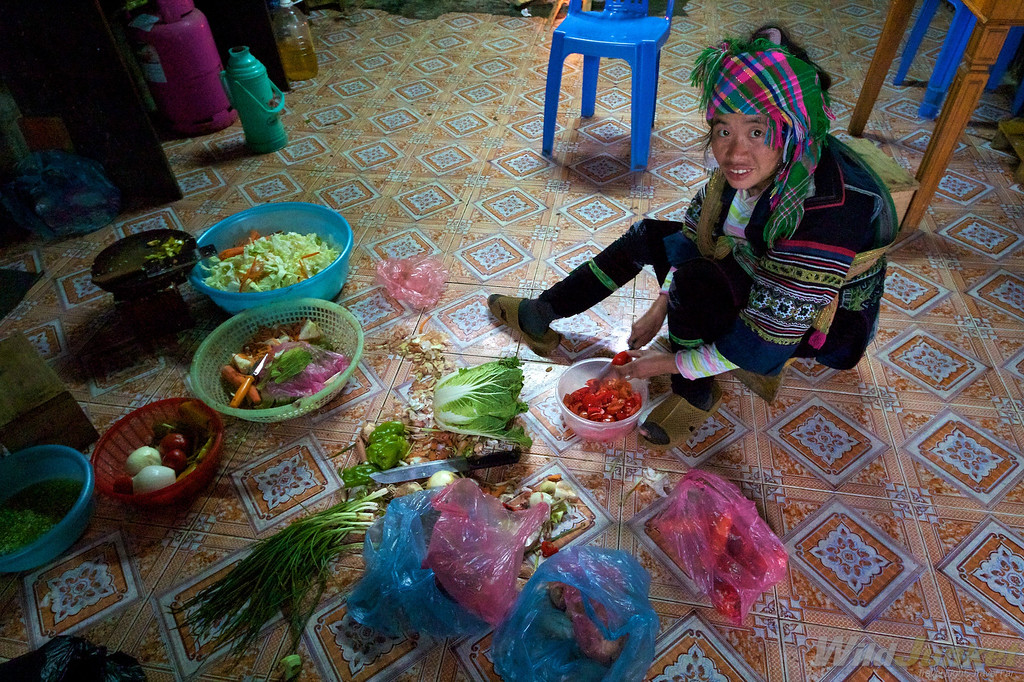 Our Hmong host cooking in her home