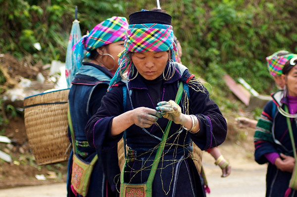 A Hmong lady working on her handicraft