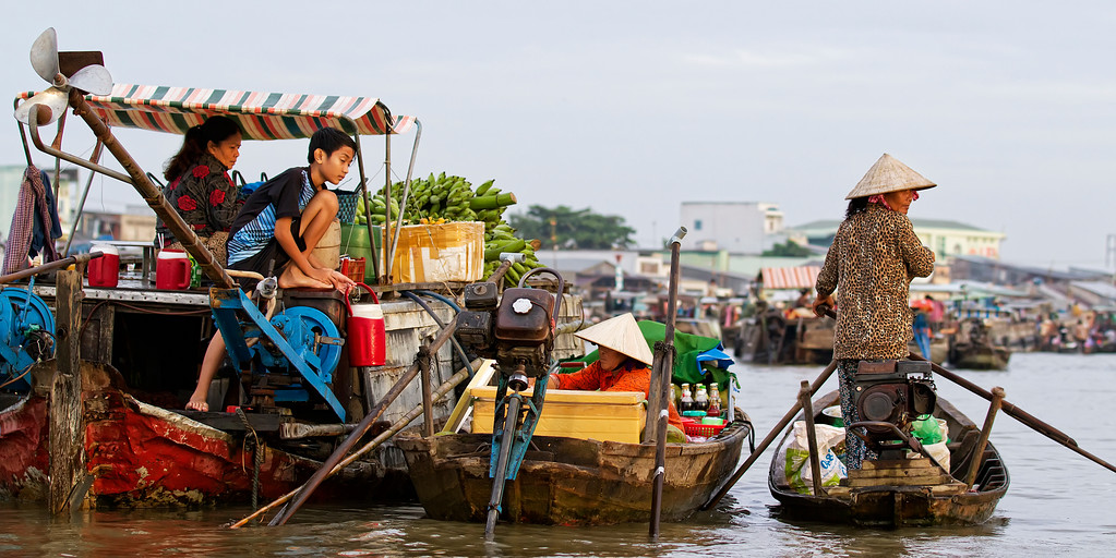 boats heading to market in the mekong delta vietnam