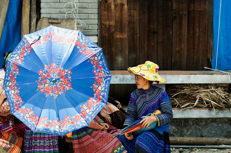 Colorful umbrella to match colorful attires