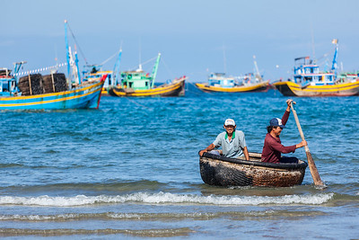Two fishermen in a coracle boat returning from fishing