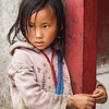SAPA, VIETNAM - JUNE 10, 2011: Unidentified vietnamese girl in Ta Van village. Though Vietnam's economic growth rate is among the highest in the world, poverty rate is still high