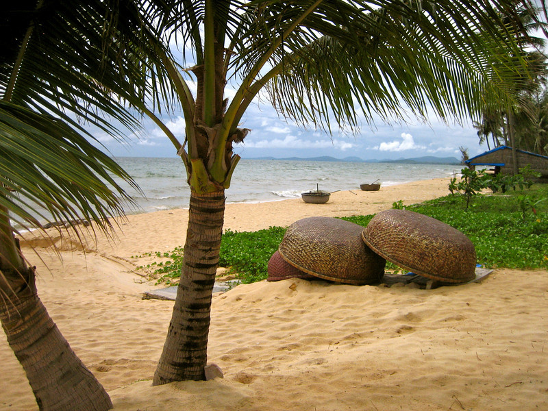 Vietnamese-style fishing boats at rest on a beach on Phu Quoc Island.