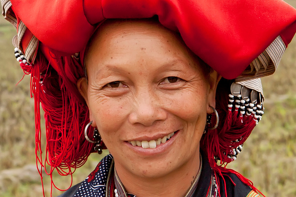 red dao portrait with headress smiling
