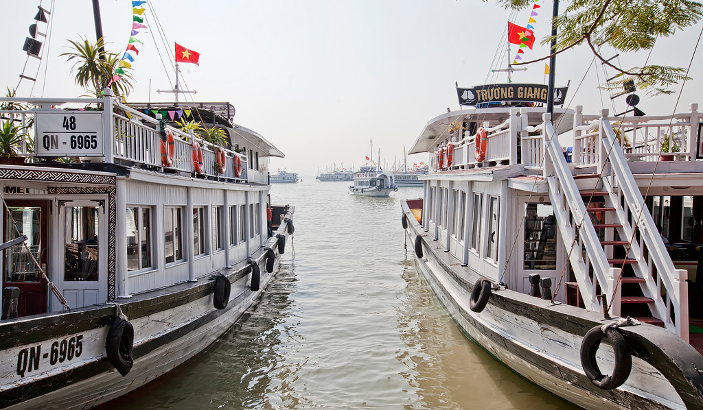two vietnamese tourboats at the dock