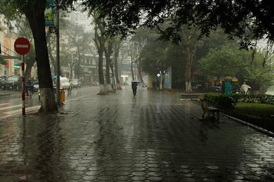 Hanoi, Vietnam A rainy street beside Hoan Kiem Lake in the Old Quarter of Hanoi.