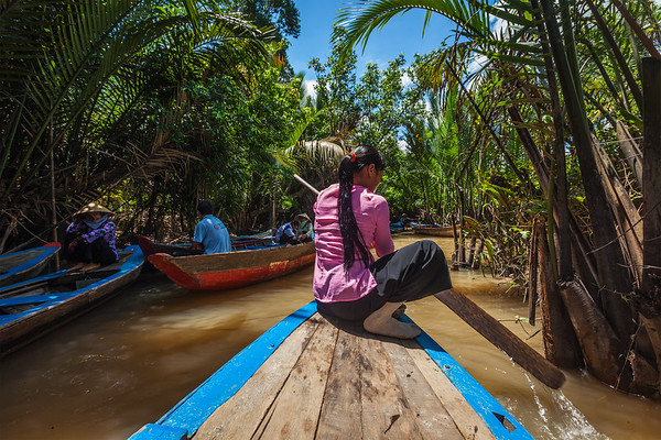 CAN THO,VIETNAM - 3 JUNE, 2011: Unidentified woman rowing on boat in Mekong river delta. Boats are common transport in Mekong delta