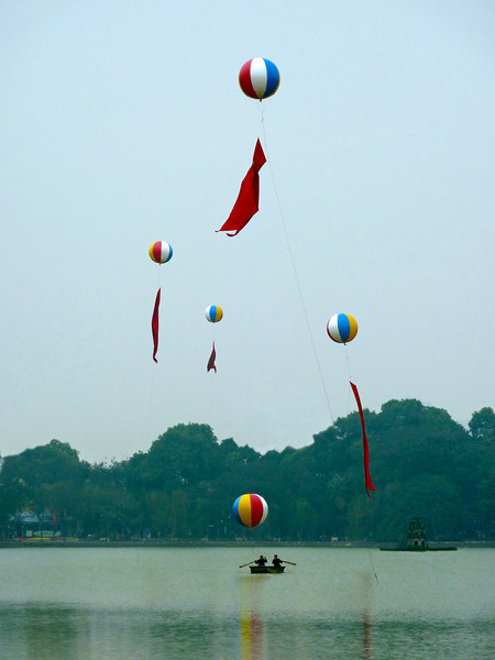 Balloons being launched in celebration at Hoan Kiem Lake in Hanoi, Vietnam.