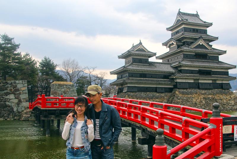 Couple Posing in Front of Matsumoto Castle Bridge