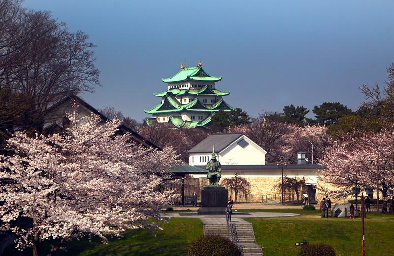 Japan, Nagoya Palace, Emperor Kato Kiyomasa statue Statue and Blooms