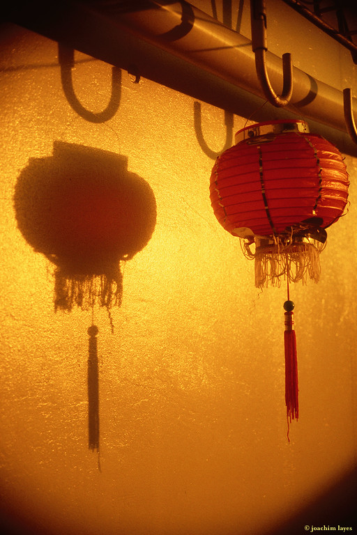 Lonely red lantern in the evening sun