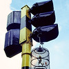 Hanging bird case at a traffic light in Singapore
