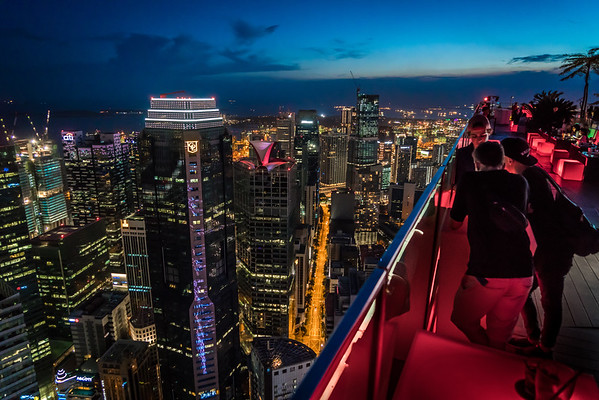 Friends Gather at a Rooftop Lounge High Above Singapore's Central Business District