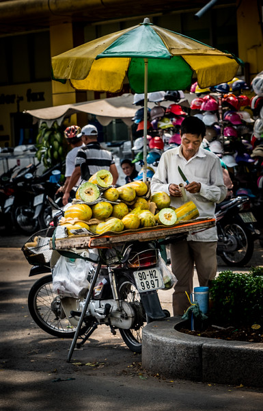 Saigon Steet Vendor Prepares Mangoes for Sale