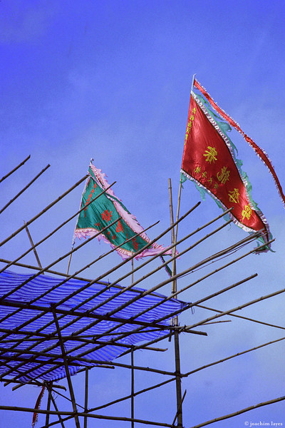 Raised flags and bamboo scaffolding