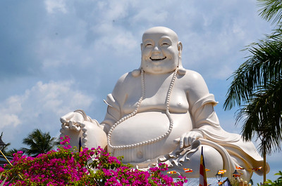 Laughing Budha at Vinh Trang Temple